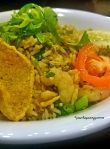 Typical Nasi (Rice) meal in Malaysia served with chips, sliced tomatoes and fresh vegetables.