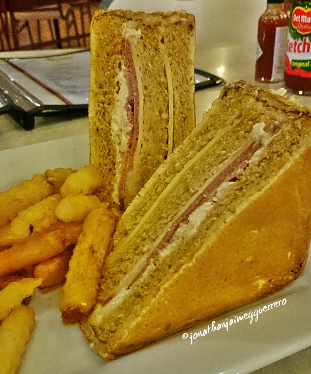 Try this bestseller sandwich at Executive Plaza Hotel. Monte Cristo sandwich is sliced bread filled with fillet of chicken, ham and cheese, coated with beaten egg and grilled to perfection! =) Served with some fries. =)