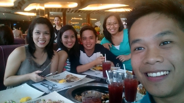 With my college best friends here. =) Food always tastes a lot better when you share it with people!