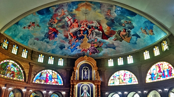 The paintings in the ceiling of the church was done by a local painter.