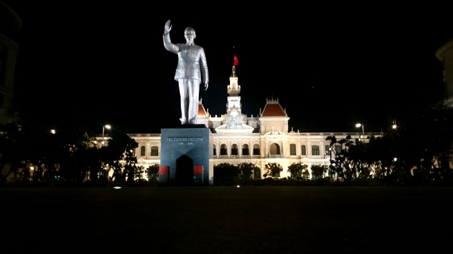 A statue of Ho Chi Minh stands a few feet across the city capitol. Guards are on the look out day and night.