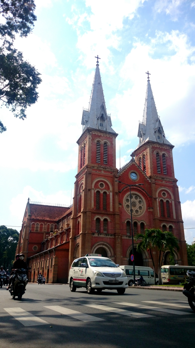 The Saigon Notre Dame Basilica has two prominent bell towers, reaching a height of 58 meters. It follows a Romanesque style of architecture.